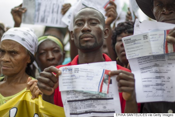 Haitian sugar cane workers rally in front of the Haitian embassy demanding the Haitian passports needed to regularize their migration status in the Dominican Republic, in Santo Domingo on June 1, 2015.  AFP PHOTO/Erika SANTELICES        (Photo credit should read ERIKA SANTELICES/AFP/Getty Images)